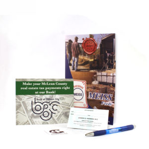 Examples of postcards, business cards, pens, and booklets that are printed by Pro-Type Printing